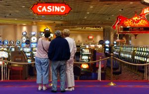 Patrons at the Trump Taj Mahal look onto the gaming floor during a shutdown that closed casino gambling in Atlantic City, N.J, Friday, July 7, 2006. New Jersey lawmakers are preparing to vote on a state budget that would end the three-day shutdown and reopen the city's 12 casinos. (AP Photo/Mary Godleski)